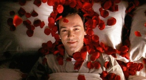 """The movie """"American Beauty"""", directed by Sam Mendes and written by Alan Ball. Seen here, Kevin Spacey as Lester Burnham fantasizing about Angela Hayes on a bed of red rose petals. Initial theatrical wide release October 1, 1999. Screen capture. © 1999 DreamWorks. Credit: © 1999 DreamWorks / Flickr / Courtesy Pikturz. Image intended only for use to help promote the film, in an editorial, non-commercial context."""