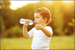 boy-drinking-water-696x465